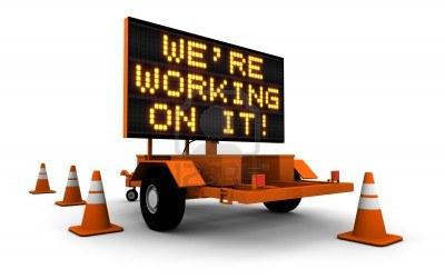 11578852-haute-resolution-3d-render-de-message-board-construction-des-signes-et-des-cones--nous